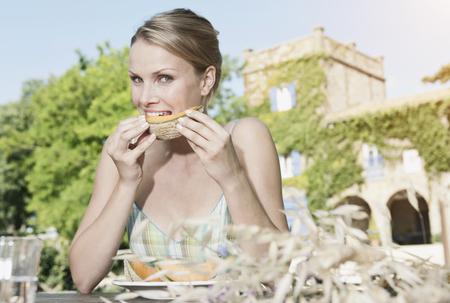 Italy,Tuscany,Magliano,Young Woman Eating Honey Melon,Portrait