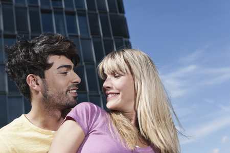 Germany,Cologne,Young Couple Looking At Each Other,Smiling LANG_EVOIMAGES