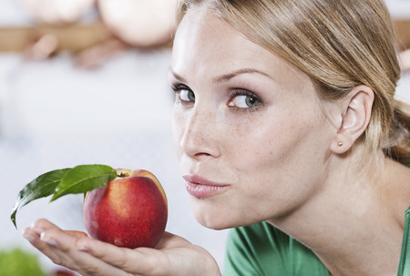 Italy,Tuscany,Magliano,Close Up Of Young Woman Holding Apple,Portrait