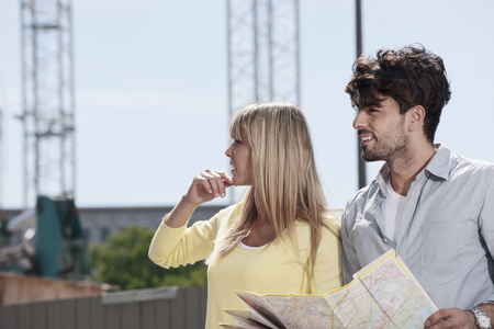 Germany,Cologne,Young Couple With Map LANG_EVOIMAGES