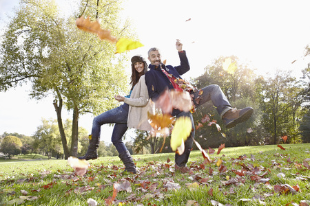 scarves: Germany,Cologne,Couple Playing In Park,Smiling,Portrait