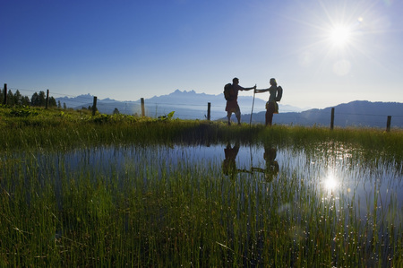 Austria,Salzburg,Couple Having Fun At Alpine Lake
