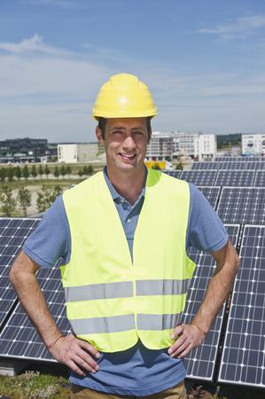 Germany,Munich,Technician In Solar Plant,Smiling,Portrait