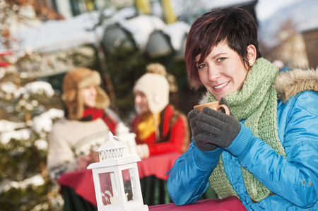Austria,Salzburg,Young Woman With Cup,People In Background LANG_EVOIMAGES
