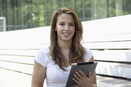 Europe,Germany,North Rhine Westphalia,Duesseldorf,Young Student With Touchpad,Smiling,Portrait LANG_EVOIMAGES
