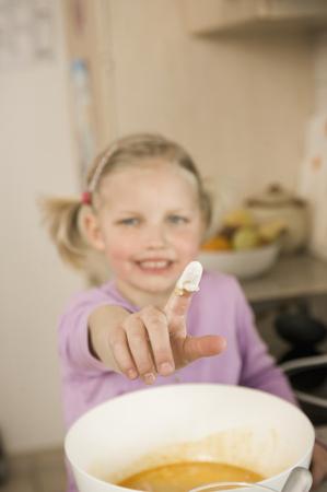 Girl Showing Finger Covered With Flour,Smiling,Portrait LANG_EVOIMAGES