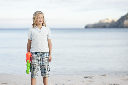 Spain,Mallorca,Boy With Water Gun On Beach