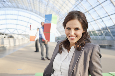 Germany,Leipzig,Businesswoman Smiling With Businessman In Background