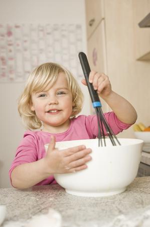 Girl Mixing Cake Ingredients In Bowl LANG_EVOIMAGES