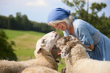 Germany,Bavaria,Mature Woman Playing With Sheep On Farm LANG_EVOIMAGES