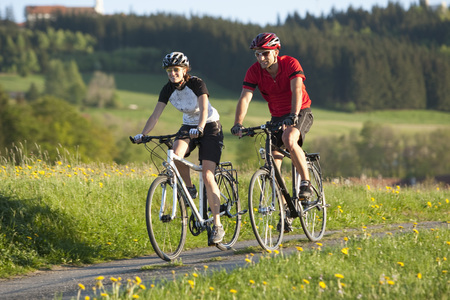 Germany,Bavaria,Man And Woman Riding Bicycle