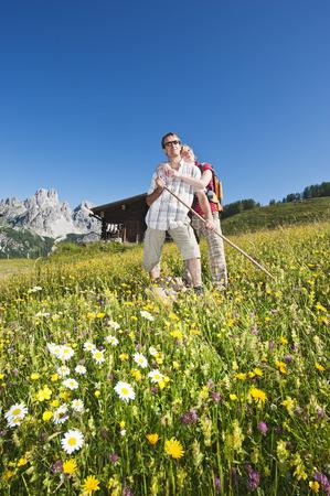Austria,Salzburg,Filzmoos,Couple Standing In Alpine Meadow