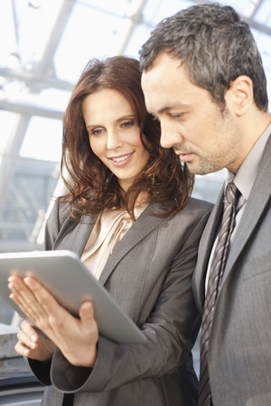 Germany,Leipzig,Business People Using Digital Tablet LANG_EVOIMAGES