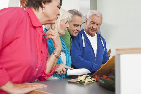 Germany,Leipzig,Senior Men And Women Cooking Food LANG_EVOIMAGES