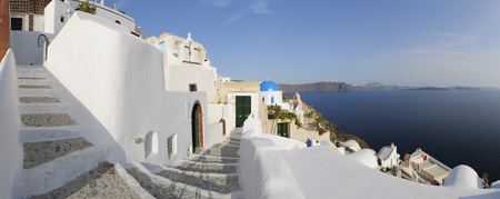 closed community: Greece,View Of Oia Village With Cobbled Path At Santorini