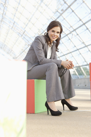Germany,Leipzig,Businesswoman With Cubes,Smiling,Portrait LANG_EVOIMAGES