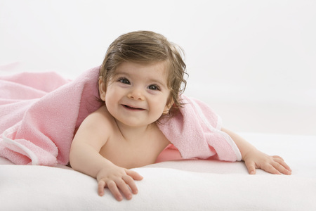 Baby Girl With Pink Blanket,Smiling LANG_EVOIMAGES