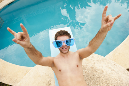 Spain,Mallorca,Young Man With Funny Glasses On Diving Board,Smiling