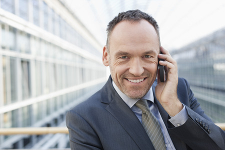 Germany,Leipzig,Businessman On Cell Phone,Smiling,Portrait