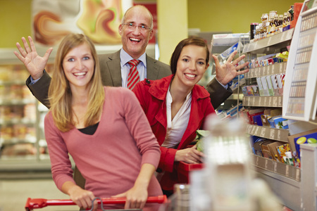 Germany,Cologne,Man And Women In Supermarket,Smiling,Portrait