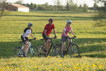 Germany,Bavaria,Man And Women Riding Bicycle