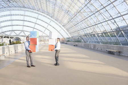 Germany,Leipzig,Business People Holding Cubes