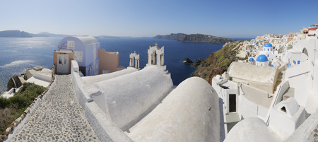 closed community: Greece,View Of Oia Village With Bell Tower Of Greek Orthodox Church At Santorini