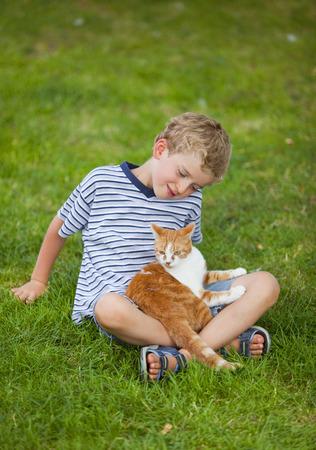only boys: Germany,Bavaria,Boy With Cat On Farm