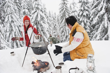 cup four: Austria,Salzburg,Man And Woman By Fireplace,People Carrying Christmas Tree In Background LANG_EVOIMAGES