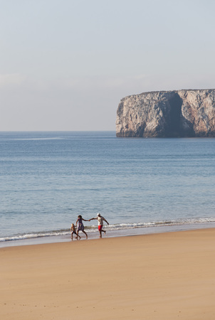 Portugal,Family Running On Beach LANG_EVOIMAGES