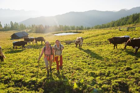 Austria,Salzburg,Couple Walking Through Alpine Meadow