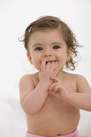 Baby Girl With Finger In Mouth,Portrait