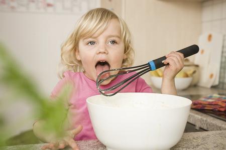 Girl Preparing Cake,Tasting Batter LANG_EVOIMAGES