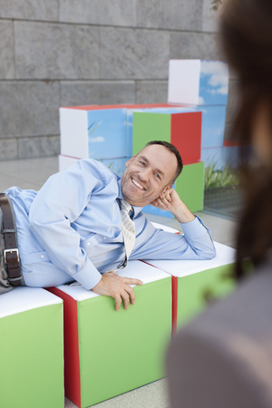 Germany,Leipzig,Business People Resting On Cubes LANG_EVOIMAGES