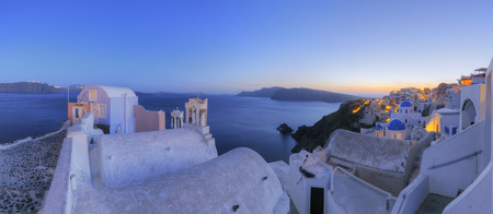 Greece,View Of Oia Village With Bell Tower Of Greek Orthodox Church At Santorini
