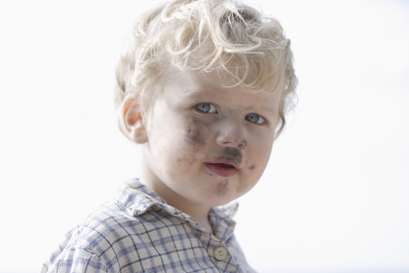 cruddy: Germany,Bavaria,Boy With Charcoal On His Face,Close Up