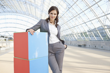 career fair: Germany,Leipzig,Businesswoman With Cubes,Smiling,Portrait LANG_EVOIMAGES