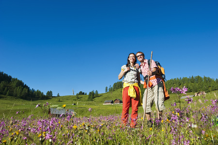 Austria,Salzburg,Couple Standing In Alpine Meadow LANG_EVOIMAGES