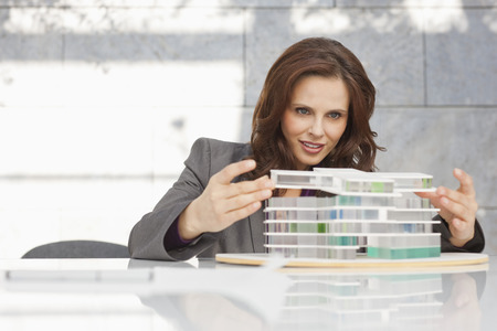 Germany,Leipzig,Businesswoman Looking At Architectural Model