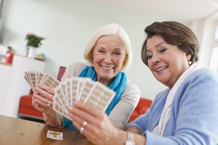 Germany,Leipzig,Senior Women Playing Card Game,Smiling