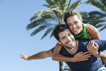 looking for love: Spain,Mid Adult Man Giving Piggy Back Ride To Woman,Smiling
