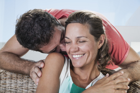 Spain,Mid Adult Man Kissing To Woman