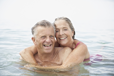 Spain,Senior Couple Swimming In Sea LANG_EVOIMAGES