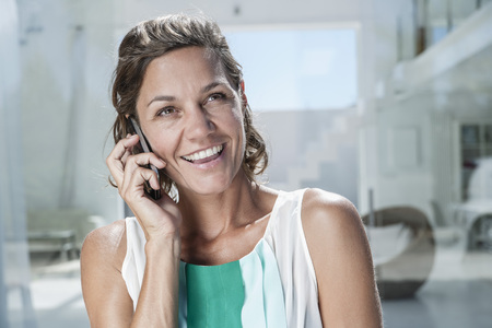 Spain,Mid Adult Woman Talking On Cell Phone LANG_EVOIMAGES