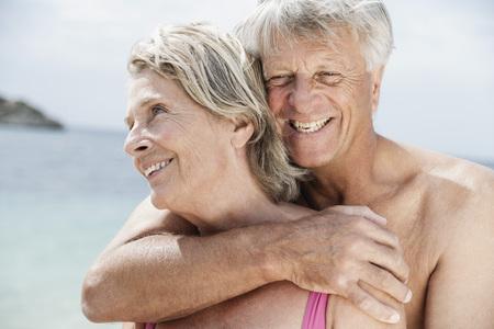nackte brust: Spain,Senior Couple Embracing On Beach
