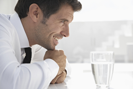 Spain,Businessman Thinking,Smiling LANG_EVOIMAGES
