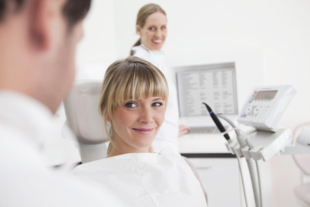 Germany,Dentist And Patient In Clinic,Smiling LANG_EVOIMAGES