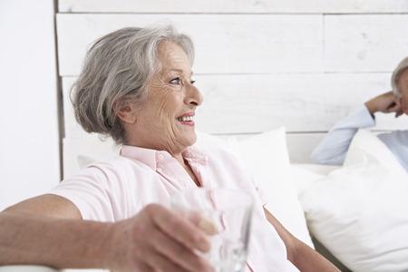 Spain,Senior Couple Relaxing In Hotel,Smiling