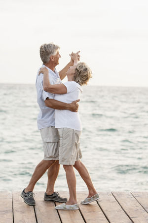 Spain,Senior Couple Dancing On Jetty At The Sea LANG_EVOIMAGES