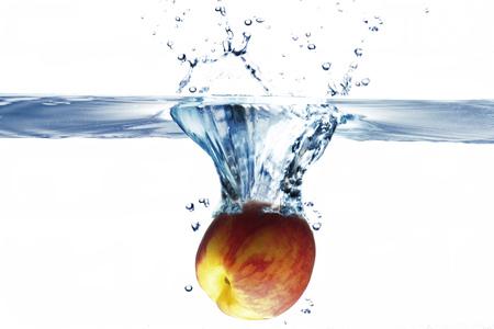 declining: Peach Splashing Into Water